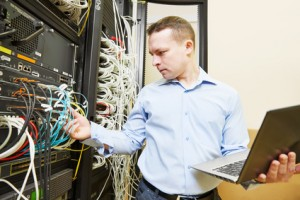 Networking administrating service. network engineer administrator checking and installing software at server hardware equipment of data center